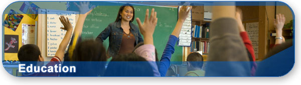 Education section banner with photo of teacher and kids in a classroom.